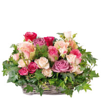 romantic basket of roses in various shades of pink