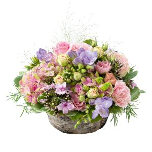 basket of seasonal flowers in pink and parm colours