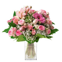 round bouquet of seasonal flowers in different shades of pink